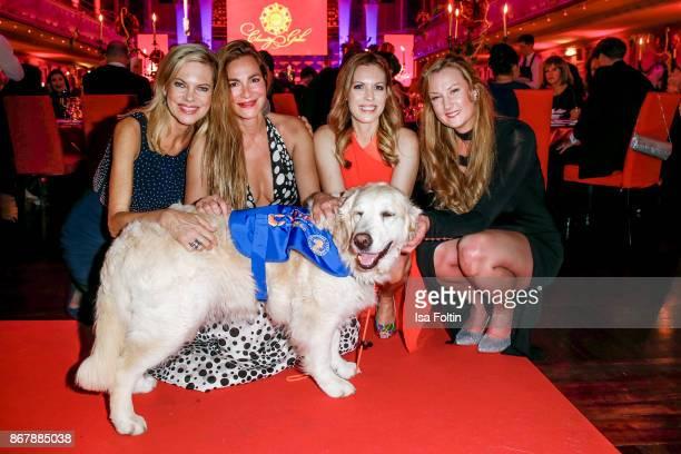 German presenter Nina Ruge German actress Alexandra Kamp German presenter Jule Goelsdorf German actress Daniela Schwerdt and an assistance dog during...