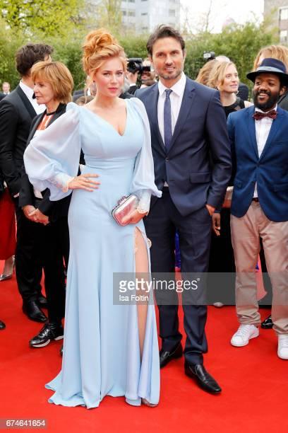 German presenter Palina Rojinski and german actor Simon Verhoeven during the Lola German Film Award red carpet arrivals at Messe Berlin on April 28...