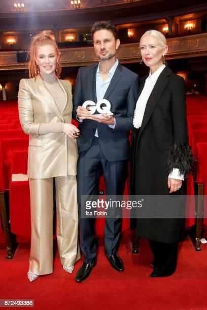 German presenter Palina Rojinski German actor Simon Verhoeven and Christiane Arp chief editor Vogue magazine Germany during the GQ Men of the year...