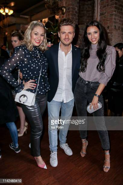 German presenter Ruth Moschner, German actor Joern Schloenvoigt and his wife Hanna Weig attend the Umami Opening on May 9, 2019 in Berlin, Germany.