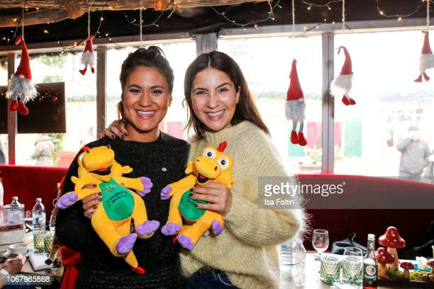 German presenter Steffi Brungs and German actress Chryssanthi Kavazi wrap a present for children in need during the Laughing Hearts Charity Christmas...
