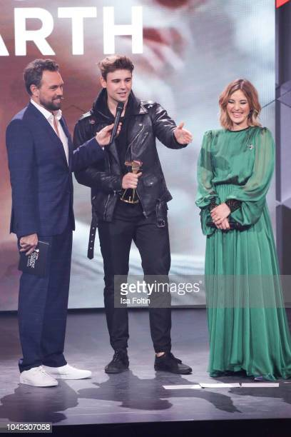 German presenter Steven Gaetjen, Youtube star, singer and award winner Moritz Garth and German presenter Jeannine Michaelsen during the YouTube...