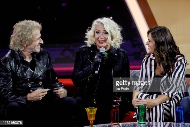 German presenter Thomas Gottschalk British singer Kim Wilde and former German figure skater and olympic gold medalist Katarina Witt at Gottschalks...