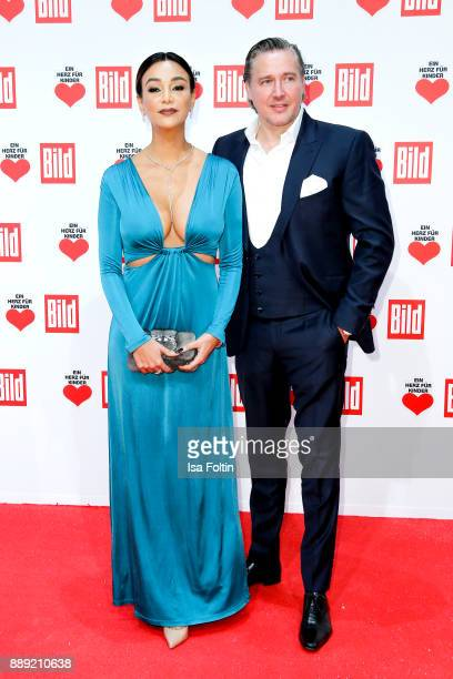 German presenter Verona Pooth and her husband Franjo Pooth attend the 'Ein Herz fuer Kinder Gala' at Studio Berlin Adlershof on December 9 2017 in...