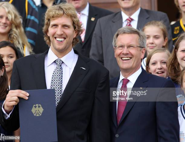 German President Christian Wulff and Dirk Nowitzki pose during the 'Silbernes Lorbeerblatt' ceremony at the presidential Bellevue palace in Berlin on...
