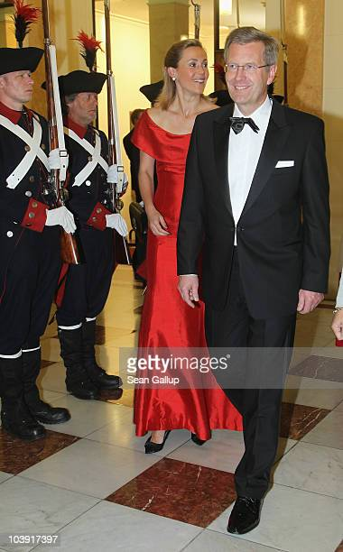 German President Christian Wulff and First Lady Bettina Wulff attend a state banquet in their honour at the Berner Hof on the first day of a twoday...