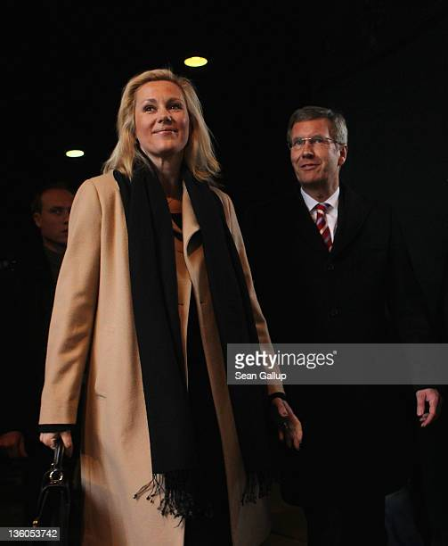 German President Christian Wulff and First Lady Bettina Wulff depart after attending a religious mass marking the 50th anniversary of the completion...