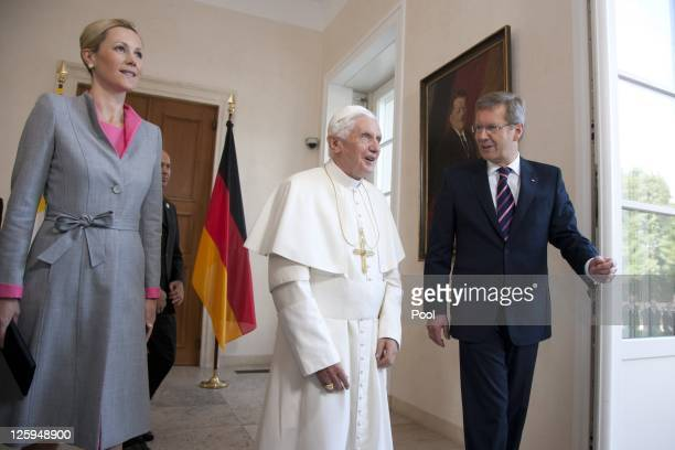 German President Christian Wulff and First Lady Bettina Wulff greet Pope Benedict XVI upon the Pope's arrival at Schloss Bellevue palace on September...