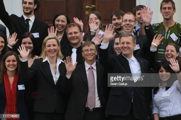 German President Christian Wulff and First Lady Bettina Wulff pose with Bill Gates , founder of Microsoft and now philanthropist, and volunteers with...