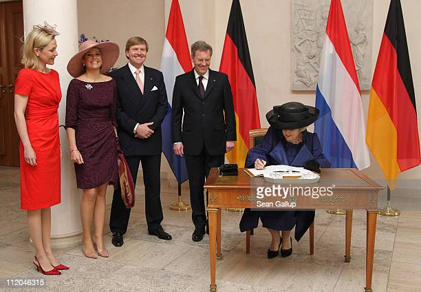German President Christian Wulff and First Lady Bettina Wulff , Prince Willem-Alexander and Princess Maxima of the Netherlands look on as Queen...