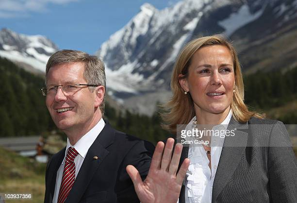 German President Christian Wulff and German First Lady Bettina Wulff pose for a picture in the Swiss Alps after arriving by helicopter for lunch on...