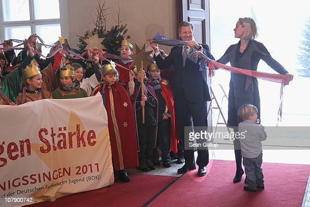 German President Christian Wulff and his wife Bettina, accompanied by their son Linus receive child Epiphany carolers at Bellevue Presidential Palace...