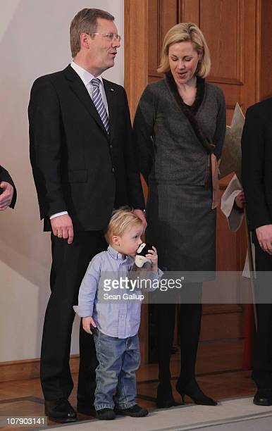 German President Christian Wulff and his wife Bettina, accompanied by their son Linus sing with child Epiphany carolers at Bellevue Presidential...