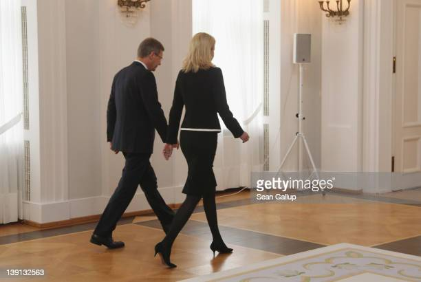 German President Christian Wulff and his wife Bettina depart after Wulff announced his resignation to the media at Bellevue Palace on February 17...