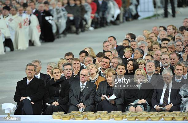 German President Christian Wulff and his wife Bettina, German Defence Minister Thomas de Maiziere, President of the German Bundestag Norbert Lammert,...