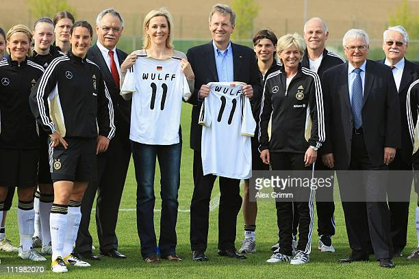 German President Christian Wulff and his wife Bettina pose with DFB President Theo Zwanziger head coach Silvia Neid and the German Women's national...