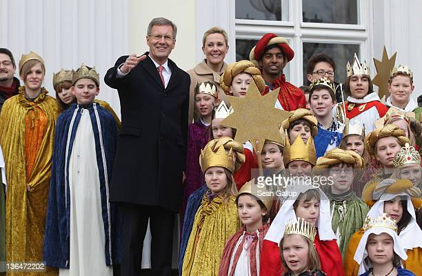 German President Christian Wulff and his wife Bettina receive child Epiphany carolers at Schloss Bellevue presidential palace on January 6 2011 in...