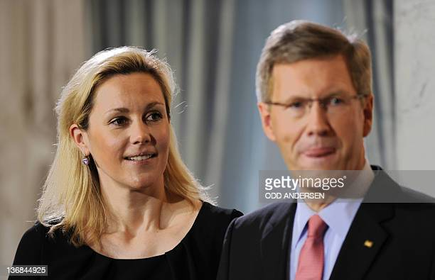 German President Christian Wulff and his wife Bettina Wulff wait for guests during a new year's reception on January 12, 2012 at Bellevue Palace in...