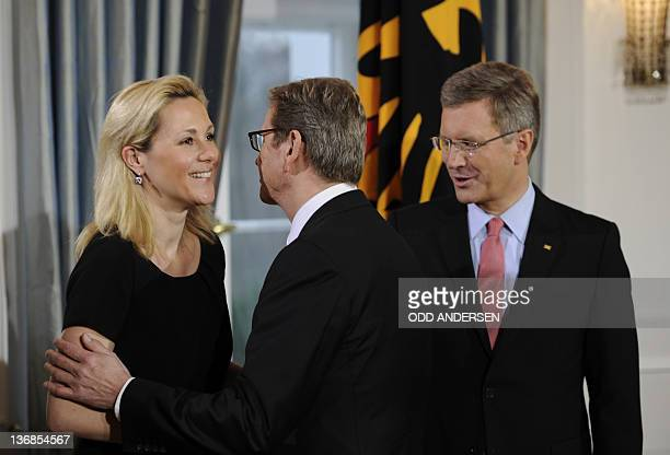 German President Christian Wulff and his wife Bettina Wulff welcome German Foreign Minister Guido Westerwelle during a new year's reception on...