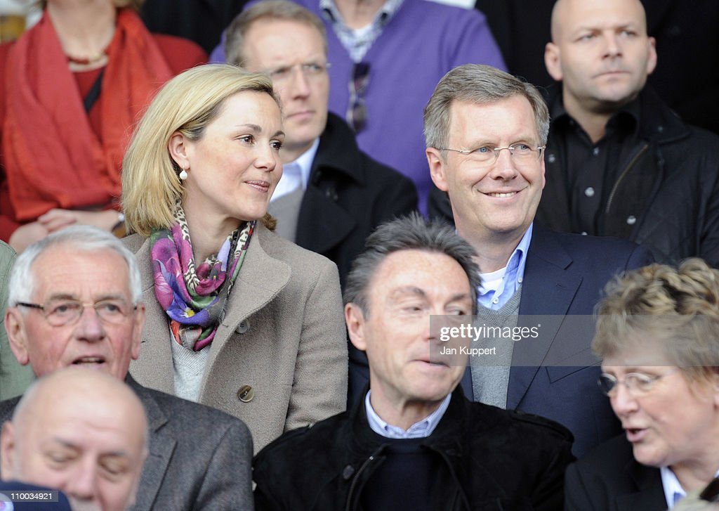 German President Christian Wulff (L) and his wife First Lady Bettina Wulff watch the Women Bundesliga match between Turbine Potsdam and Essen-Schoenebeck at the Karl-Liebknecht stadium on March 13, 2011 in Potsdam, Germany.