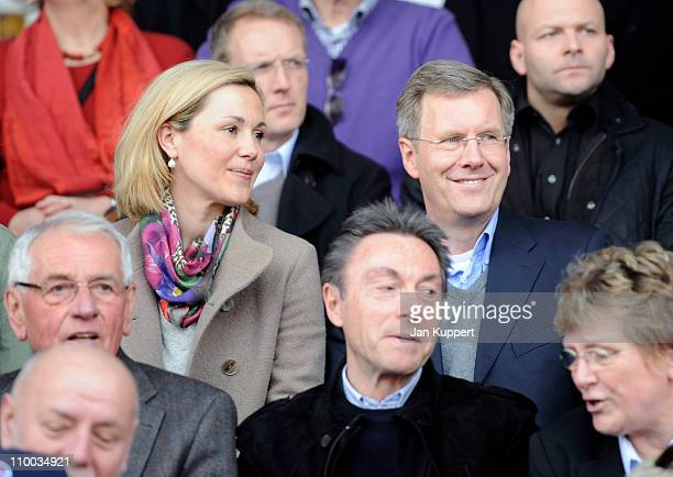 German President Christian Wulff and his wife First Lady Bettina Wulff watch the Women Bundesliga match between Turbine Potsdam and Essen-Schoenebeck...