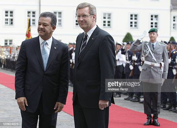 German President Christian Wulff and Leonel Fernandez Reyna President of the Dominican Republic look on after they review a guard of honour upon...