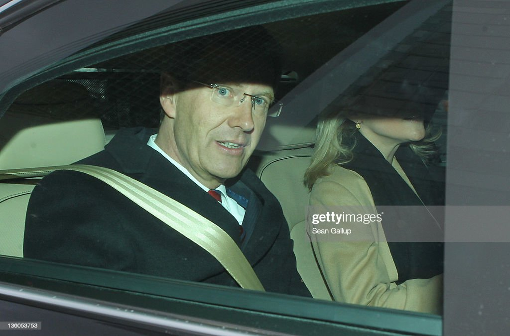 German President Christian Wulff departs after attending a religious mass marking the 50th anniversary of the completion of the Kaiser Wilhelm Memorial Church on December 18, 2011 in Berlin, Germany. Wulff is currently facing increasing pressure over a loan of EUR 500,000 from the wife of businessman Egon Geerkens while Wulff was still Prime Minister of Lower Saxony. Wulff denied having any business association with Geerkens during an inquiry by the German Greens party at the time.