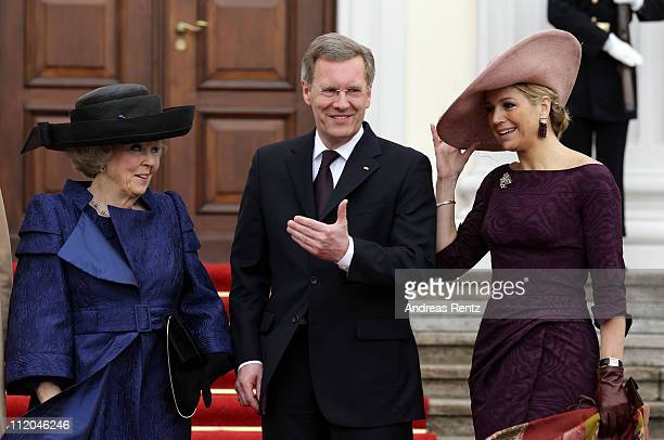 German President Christian Wulff greets Queen Beatrix and Princess Maxima of the Netherlands at Bellevue Presidential Palace on April 12, 2011 in...
