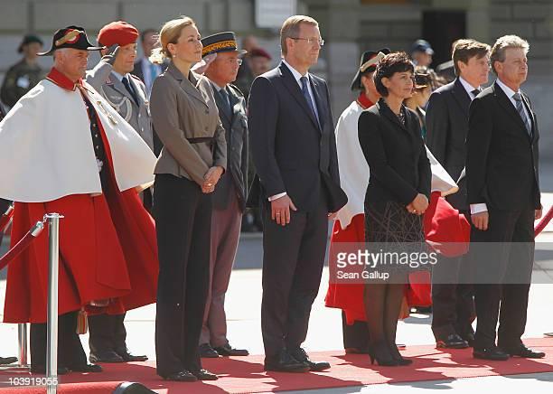 German President Christian Wulff his wife First Lady Bettina Wulff Swiss President Doris Leuthard and her husband Roland Hausin listen to their...