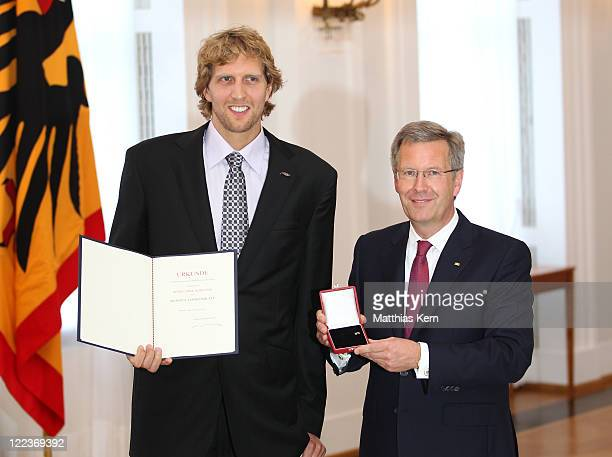 German President Christian Wulff honors Dirk Nowitzki with the 'Silbernes Lorbeerblatt' during a ceremony at the presidential Bellevue palace in...