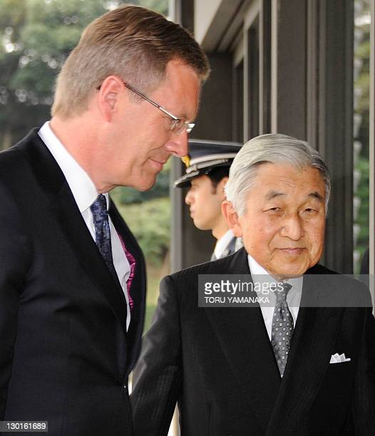 German President Christian Wulff is welcomed by Japanese Emperor Akihito upon his arrival at the Imperial Palace for their luncheon in Tokyo on...