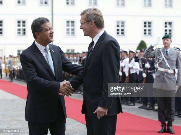 German President Christian Wulff shakes hands with Leonel Fernandez Reyna President of the Dominican Republic after they review a guard of honour...