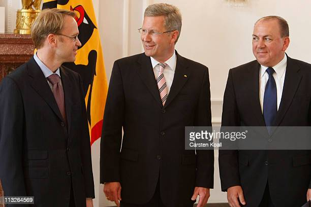 German President Christian Wulff stays after giving outgoing Bundesbank President Axel Weber his official discharge papers as new Bundesbank...