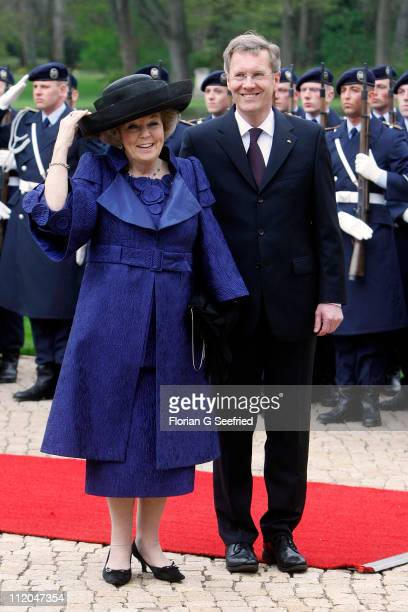 German President Christian Wulff welcomes Queen Beatrix of the Netherlands with the guard of honor at Bellevue Presidential Palace on April 12, 2011...