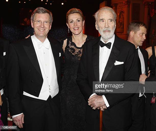German President Christian Wulff with German First Lady Bettina Wulff and Sir Christopher Lee attend the Semper Opera ball on January 14, 2011 in...