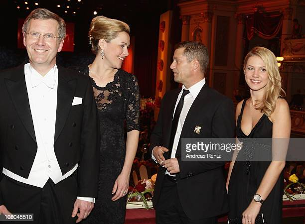 German President Christian Wulff with German First Lady Bettina Wulff and Til Schweiger with Svenja Holtmann attend the Semper Opera ball on January...