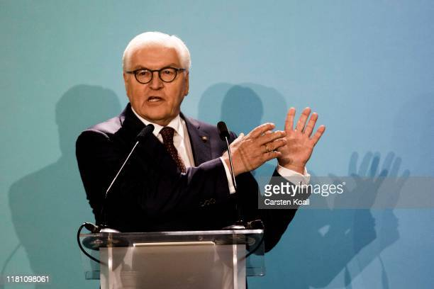 German President Frank Walter Steinmeier speaks in front of the Brandenburg Gate on the 30th anniversary of the fall of the Berlin Wall on November 9...