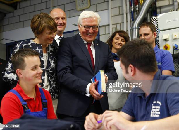 German President FrankWalter Steinmeier and First Lady Elke Buedenbender Chat with trainees while visiting the Gallinchen job training and technology...