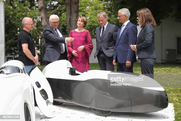 German President FrankWalter Steinmeier and First Lady Elke Buendenbender gets informed at the research group 'Efficient Mobility' booth of the...