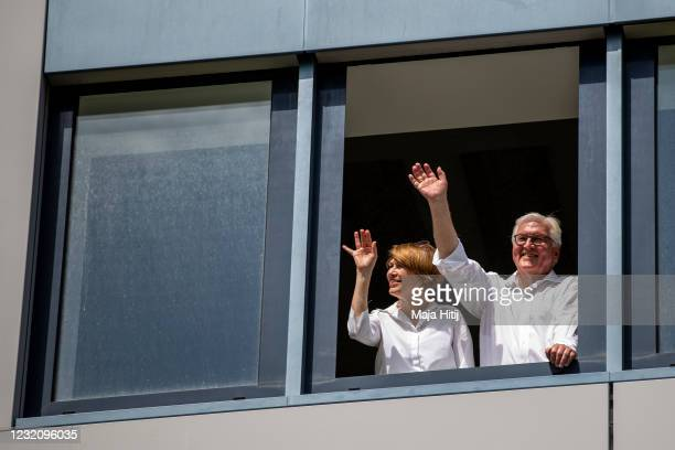German President FrankWalter Steinmeier and German First Lady Elke Buedenbender wave to neighbours as he and his wife Elke Buedenbender attend the...