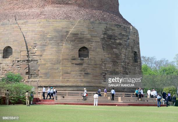German President FrankWalter Steinmeier and his delegation visit the Dhamekh Buddhist Stupa in Sarnath some 12km from Varanasi on March 22 2018 / AFP...
