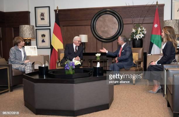 German president FrankWalter Steinmeier and his wife Elke Buedenbender are received with by Jordan's King Abdullah II in Amaan Jordan 28 January 2018...