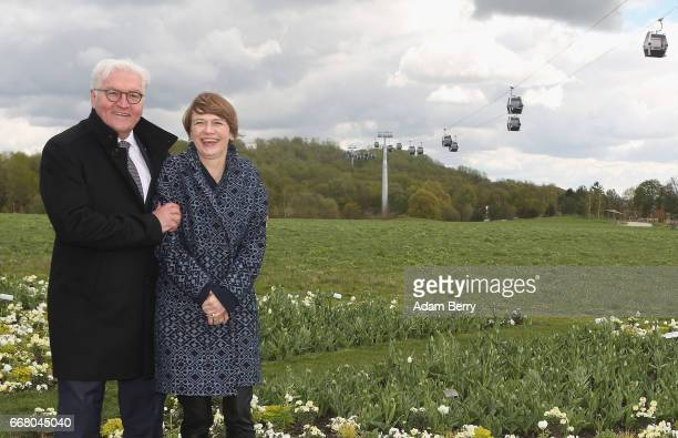German President FrankWalter Steinmeier and his wife Elke Buedenbender attend the opening of the IGA International Garden Exhibition as aerial lifts...