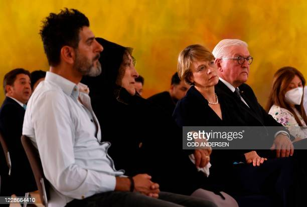 German President Frank-Walter Steinmeier and his wife Elke Buedenbender listen to speeches after meeting relatives of Hanau attack victims on...