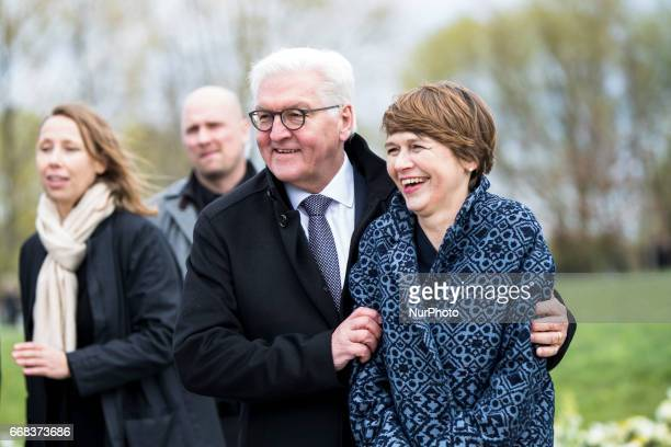 German President FrankWalter Steinmeier and his wife Elke Buedenbender pose for a picture during the opening of the IGA 2017 in Berlin Germany on...