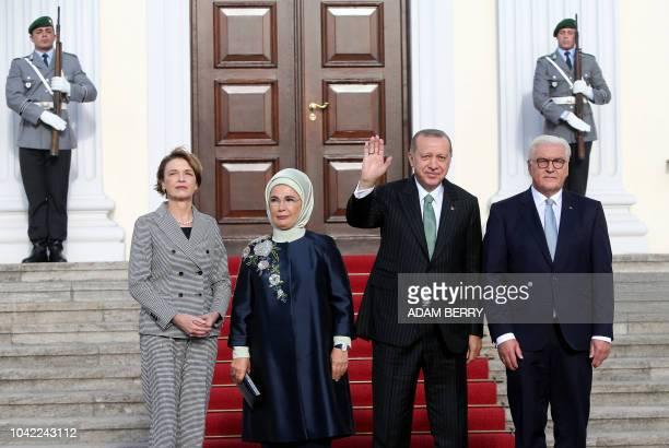German President FrankWalter Steinmeier and his wife Elke Buedenbender pose with Turkish President Recep Tayyip Erdogan and his wife Emine Erdogan...
