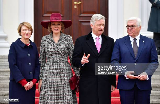 German President FrankWalter Steinmeier and his wife Elke Buedenbender pose with King Philippe of Belgium and Queen Mathilde of Belgium in front of...