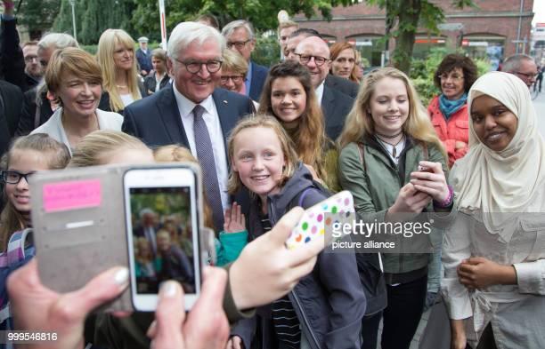 German President FrankWalter Steinmeier And His Wife Elke Buedenbender Take Photos With Students In Muenster Germany