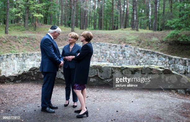 German President FrankWalter Steinmeier and his wife Elke Buedenbender visiting the Paneriai Holocaust Memorial together with the Chairwoman of the...