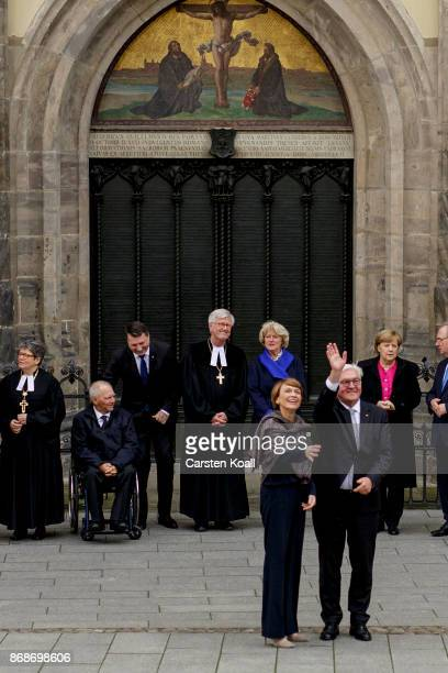 German President FrankWalter Steinmeier and his wife Elke Buedenbender wave as they wait together with German Chancellor Angela Merkel Protestant...